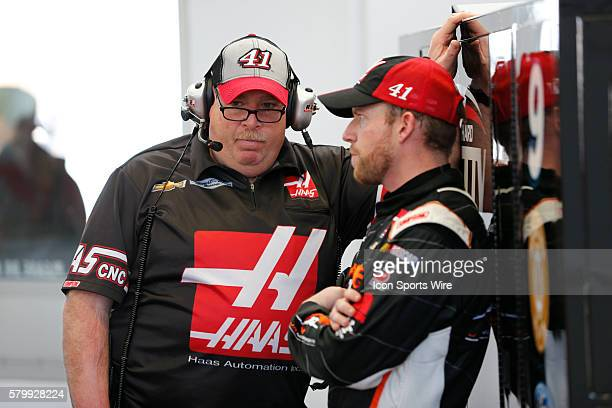 Regan Smith StewartHass Racing Chevrolet Impala SS and his crew chief Tony Gibson during practice for the Kobalt Tools 400 Sprint Cup Series at Las...