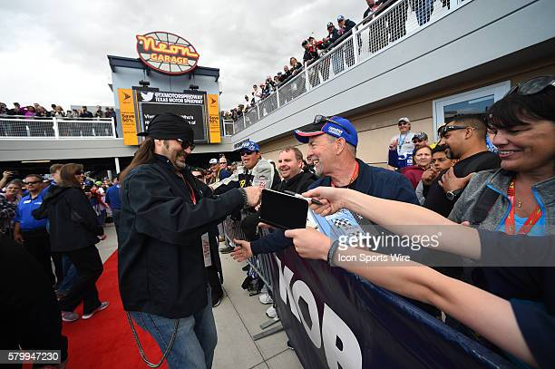Danny Koker of History Channel's Counting Cars signs autographs during the drivers meeting in the Neon Garage prior to the start of the Kobalt 400...
