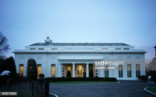 A March 6 2018 photo shows the West Wing of the White House at dusk in Washington DC