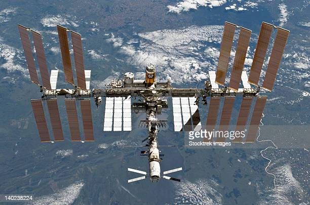 March 7, 2011 - The International Space Station backgropped by a blue and white Earth.