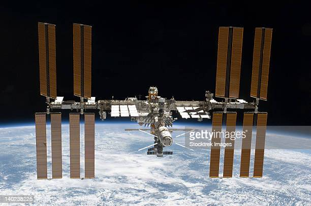 march 7, 2011 - the international space station in orbit above earth. - international space station stock pictures, royalty-free photos & images
