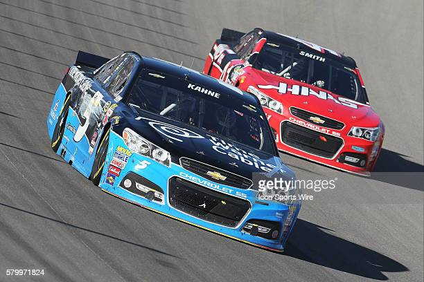 Kasey Kahne Hendrick Motorsports Chevrolet Impala SS races Regan Smith StewartHass Racing Chevrolet Impala SS during the NASCAR Sprint Cup Series...