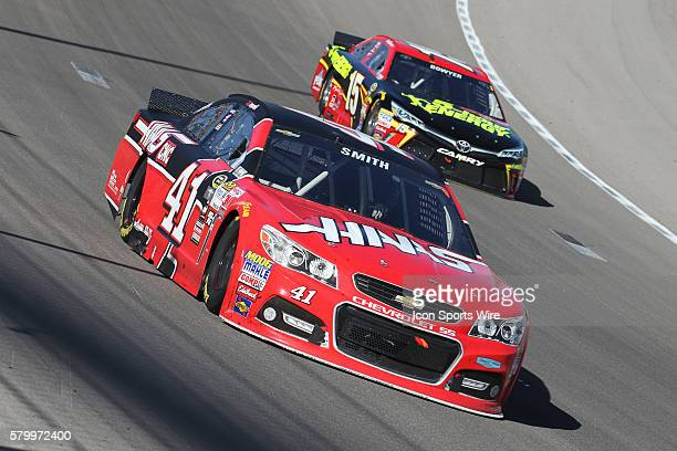 Regan Smith StewartHass Racing Chevrolet Impala SS leads Clint Bowyer Michael Waltrip Racing Toyota Camry during the NASCAR Sprint Cup Series Kobalt...