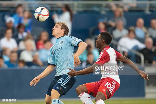 Sporting KC defender Seth Sinovic and New York Red Bulls midfielder Lloyd Sam go for the ball during the MLS opening day game between the New York...