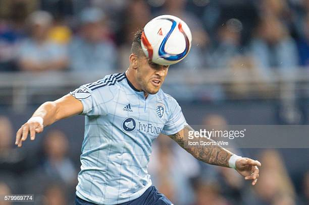 Sporting KC forward Dom Dwyer takes a header during the MLS opening day game between the New York Red Bulls and Sporting KC at Sporting Park in...