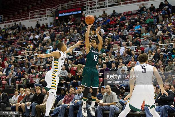 Green Bay Phoenix guard Carrington Love shoots a jump shot during the Horizon League men's basketball tournament championship game between the Green...