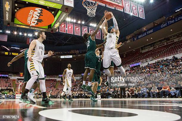 Wright State Raiders center Michael Karena puts up a shot against Green Bay Phoenix guard Tevin Findlay during the Horizon League men's basketball...