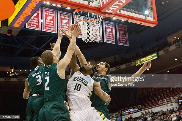 Wright State Raiders guard Biggie Minnis battles against Green Bay Phoenix guard Jordan Fouse Green Bay Phoenix guard Turner Botz and Green Bay...