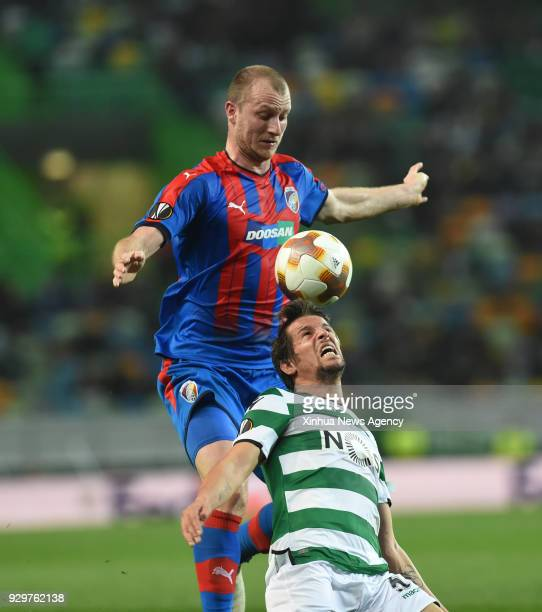 LISBON March 8 2018 Fabio Coentrao of Sporting vies for the ball with Michal Krmencik of Viktoria Plzen during the UEFA Europa League round of 16...