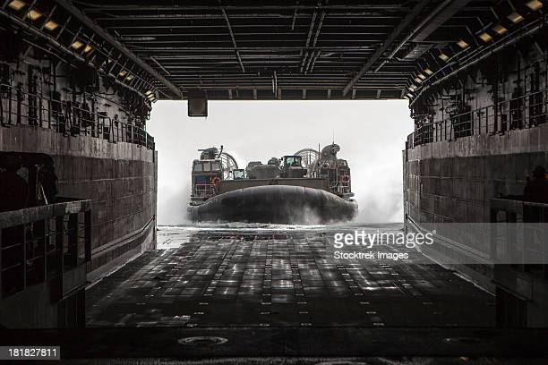 march 9, 2013 - u.s. navy landing craft air cushion enters the well deck of the uss green bay (lpd 20) in the arabian sea.  - military ship stock pictures, royalty-free photos & images