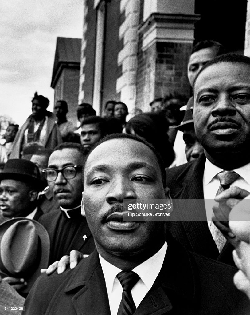 March 9, 1965, Martin Luther King Jr. stands next to Reverend Ralph Abernathy (r) and Reverend Joseph Lowery (l) at a rally held in Selma, Alabama, during marches to Montgomery.