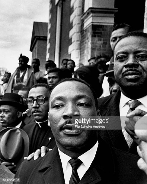 March 9 Martin Luther King Jr stands next to Reverend Ralph Abernathy and Reverend Joseph Lowery at a rally held in Selma Alabama during marches to...