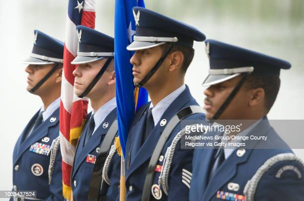 March Air Reserve Base Honor Guard take part in a short ceremony before volunteers with AFlag for Every Hero place flags at Riverside National...