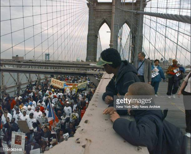 March and rally protesting the Amadou Diallo shooting crossing over the Brooklyn Bridge to City Hall
