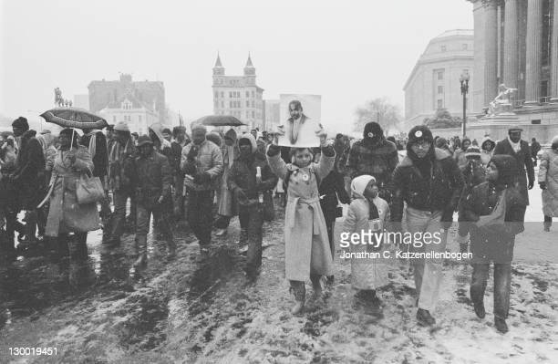 A march down Pennsylvania Avenue to publicise a campaign for Martin Luther King Jr's birthday to be made a national holiday in the US Washington DC...