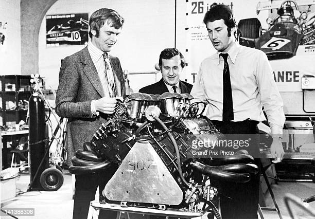 March Engineering team principals Max Mosley Alan Rees and Robin Herd with the Ford Cosworth V8 engine before the start of the 1971 Formula 1 Grand...