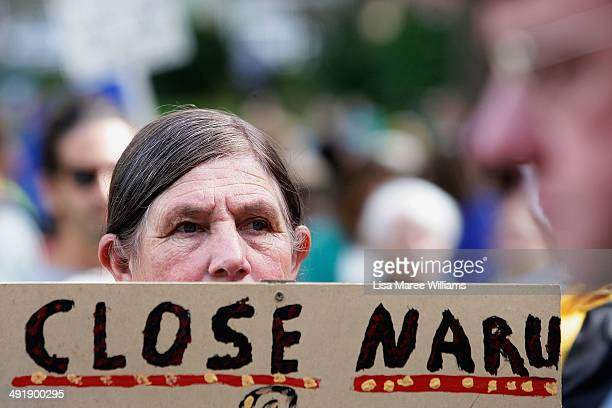 A 'March in May' protester holds a sign at Belmore Park on May 18 2014 in Sydney Australia Hundreds of 'March in May' protesters marched against the...