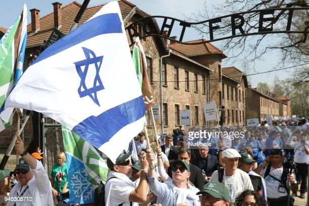 March of The Living participants with Israeli flags are seen in Auschwitz I Death Camp in Oswiecim Poland on 12 April 2018 Taking place annually on...