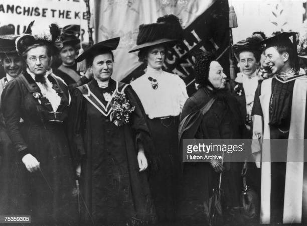 A march of the National Union of Women's Suffrage 1908 From left to right Lady Frances Balfour Millicent Fawcett Ethel Snowden Emily Davies and...