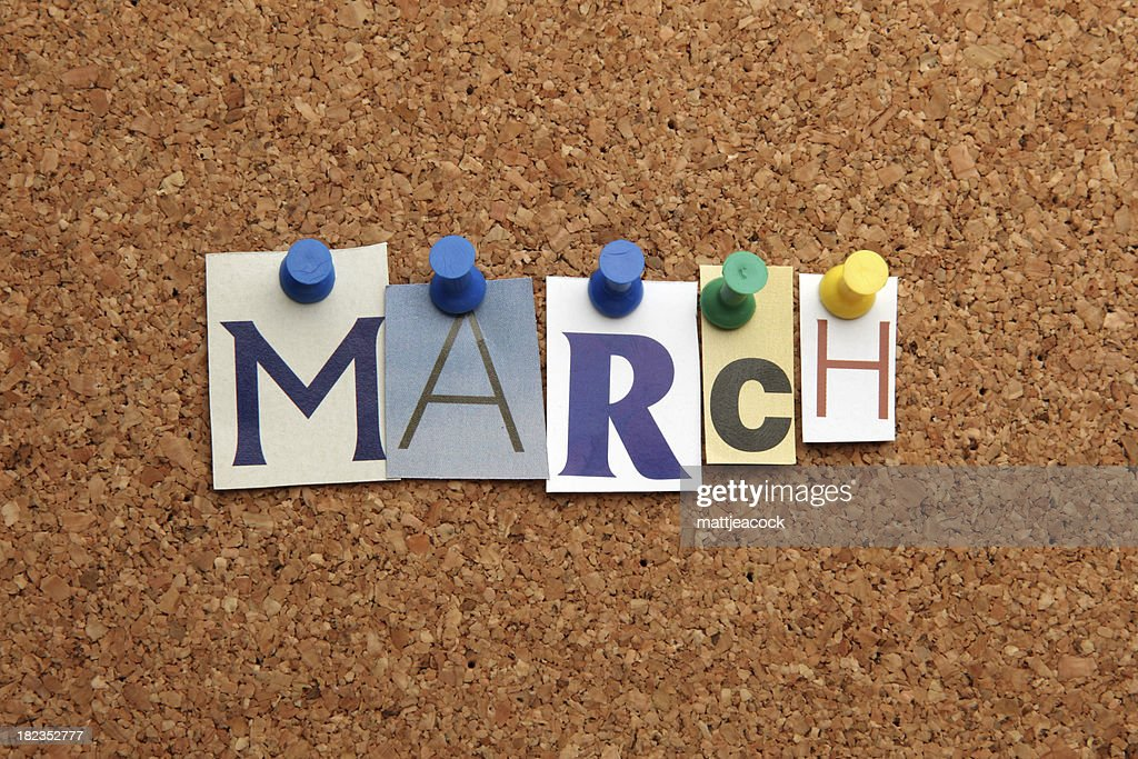 March pinned on noticeboard : Stock Photo