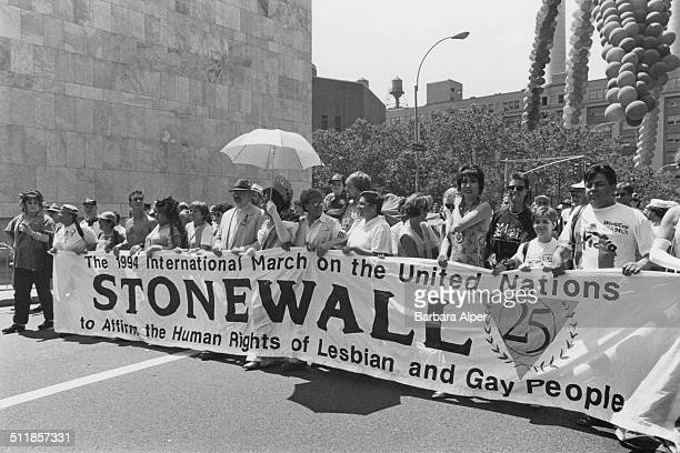 A march to commemorate the 25th anniversary of the Stonewall Riots New York City USA 26th June 1994 The banner reads 'The 1994 International March on...