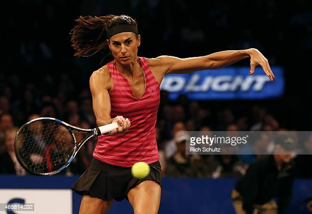 Gabriela Sabatini of Argentina returns a shot to Monica Seles of the United States during the BNP Paribas Showdown at Madison Square Garden on March...
