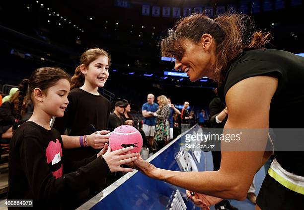 Gabriela Sabatini of Argentina signed autographs before her match against Monica Seles of the United States during the BNP Paribas Showdown at...