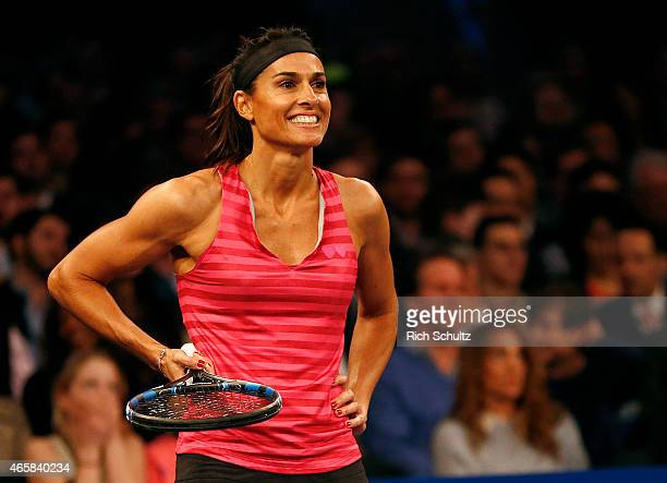 Gabriela Sabatini of Argentina smiles as she waits for Monica Seles of the United States to serve during the BNP Paribas Showdown at Madison Square...