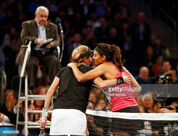 Monica Seles of the United States and Gabriela Sabatini of Argentina embrace after their match at the BNP Paribas Showdown at Madison Square Garden...