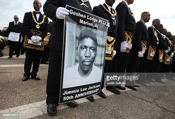 Marcher holds a poster of Jimmie Lee Jackson, a civil rights activist who was beaten and shot by Alabama State troopers in 1965, during the 50th...
