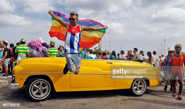 A marcher participates of a Cuban Conga during the march where hundreds of Cubans protested against homofobia and for gay rights on May 13 2017 in...