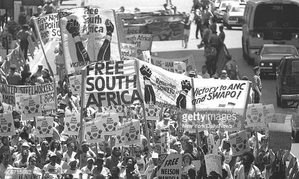 Marchers along 42d St display banners and signs protesting the racial policies in South Africa James Hughes/NY Daily News via Getty Images