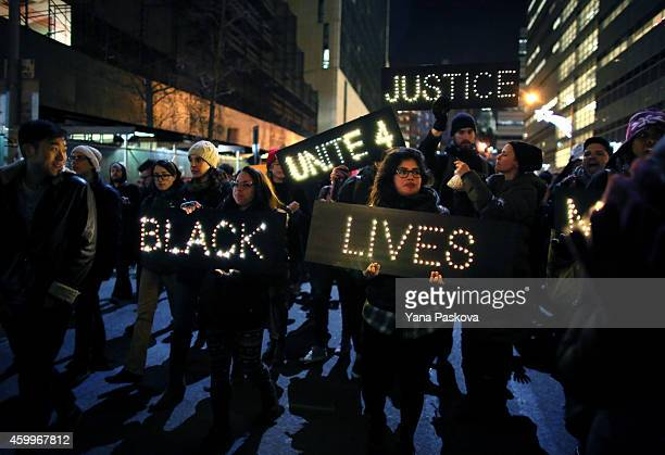 Marchers approach the West Side Highway during a protest December 4 2014 in New York Protests began after a Grand Jury decided to not indict officer...