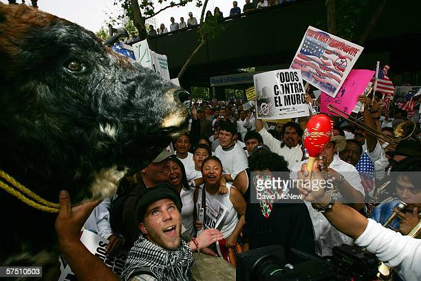Marchers carry a bulls head during a march and rally on what is dubbed a Day Without Immigrants or the Great American Boycott day on May 1 2006 in...