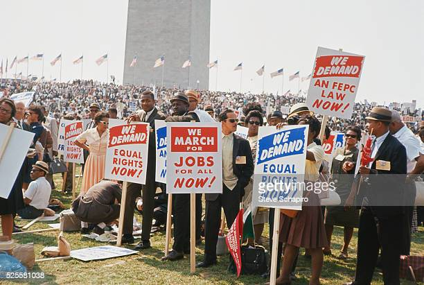 Marchers carrying signs demanding equal rights and jobs More than 200000 people participated in the March on Washington demonstrations The throng...