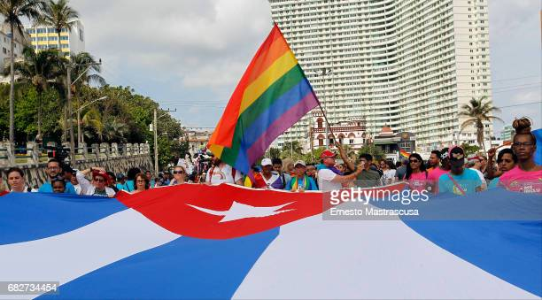 Marchers display a giant Cuba Flag during the march where hundreds of Cubans protested against homofobia and for gay rights on May 13 2017 in Havana...