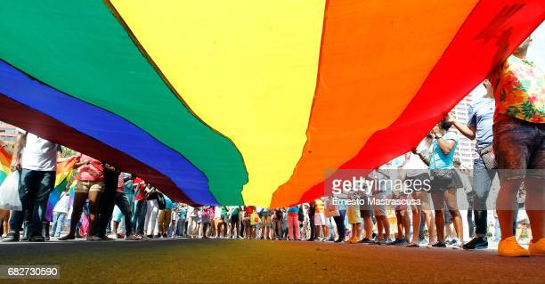 Marchers display a LGBT Flag during the march where hundreds of Cubans protested against homofobia and for gay rights on May 13 2017 in Havana Cuba