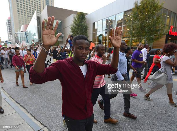 Marchers gather at the Atlanta #RallyforFerguson Justice For Mike Brown at the CNN Center on August 18 2014 in Atlanta Georgia