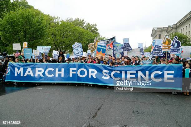 Marchers head down Constitution Avenue toward the US Capital Building during the Earth Day March for Science on April 22 2017 in Washington DC