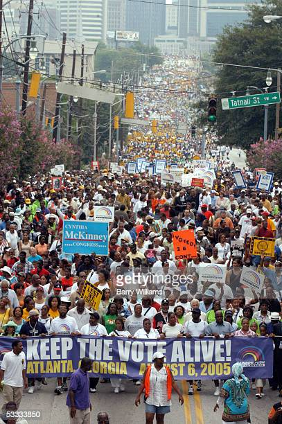 Marchers head down Martin Luther King Blvd during Keep the Vote Alive March and Rally Sat Aug 6 2005 in Atlanta The historic 1965 Voting Rights Act...