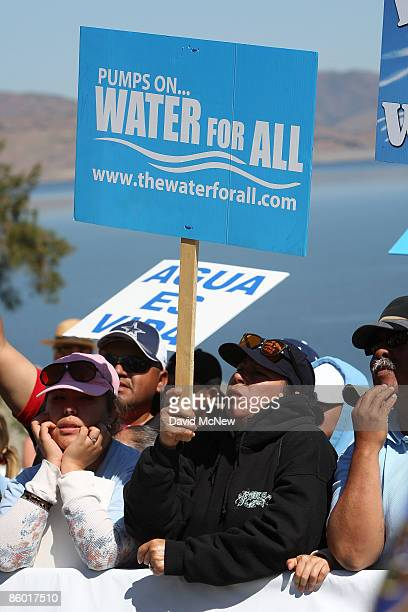 Marchers hold a rally attended by California Gov Arnold Schwarzenegger at the last stop of a fourday march through the Central Valley by farmers farm...
