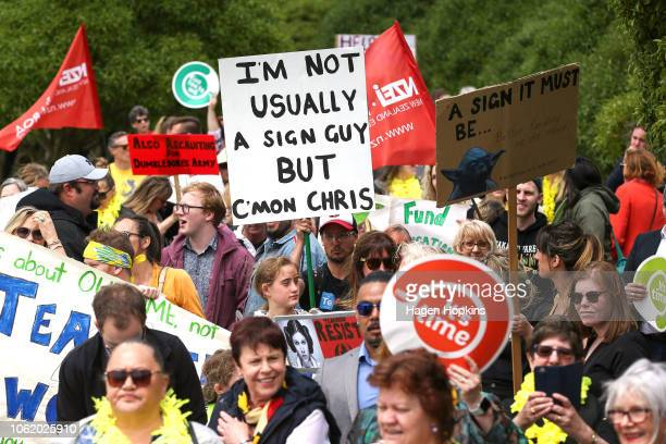 Marchers hold banners and signs during a march and rally on November 16 2018 in Wellington New Zealand More than 460000 primary and intermediate...