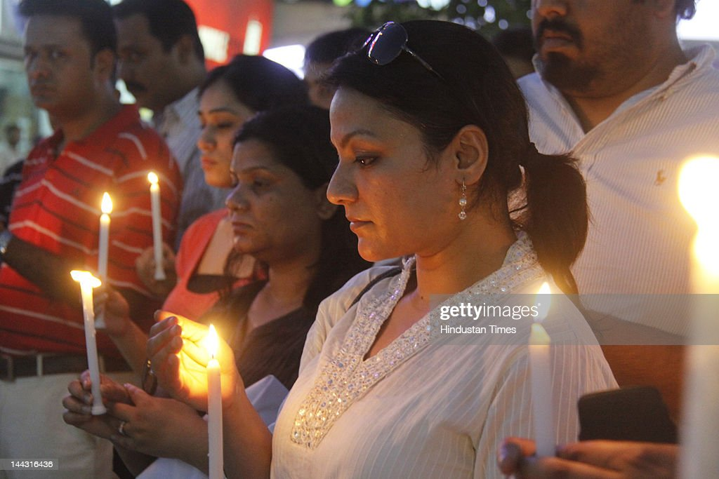 Marchers hold candles during a protest on May 13, 2012 in Gurgaon, India. Protests were held after the the death of two, including a pregnant woman, after being struck by a speeding BMW owned by Devender Sehrawat.