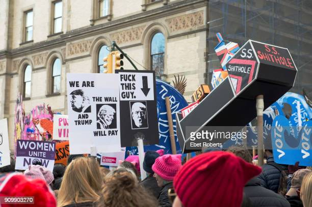 Marchers hold up placards protesting US President Donald Trump at the 2018 Women's March in New York City on January 20 2018