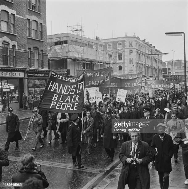 Marchers join a demonstration in Ladbroke Grove to protest against the repression of black citizens, organised by the Black Defence Committee in...