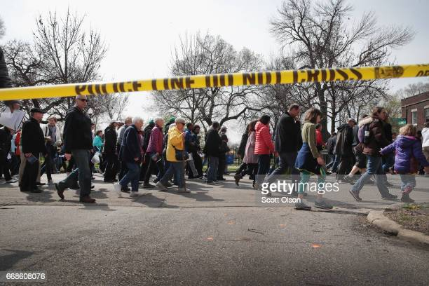 Marchers led by Cardinal Blase Cupich walk through the Englewood neighborhood calling for an end to the violence that has plagued the city on April...