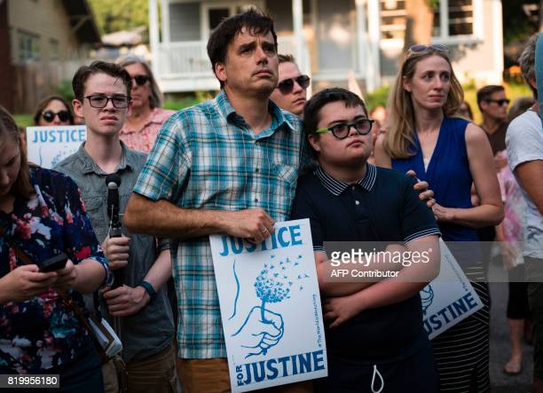 Marchers look on as Don Damond fiance of Justine Damond greets demonstrators outside his home on July 20 2017 in Minneapolis Minnesota Several days...