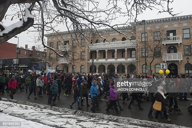 Marchers make their way down Colfax Avenue in Denver Colorado during Denver's Martin Luther King Jr parade on January 2017 Denver's Martin Luther...