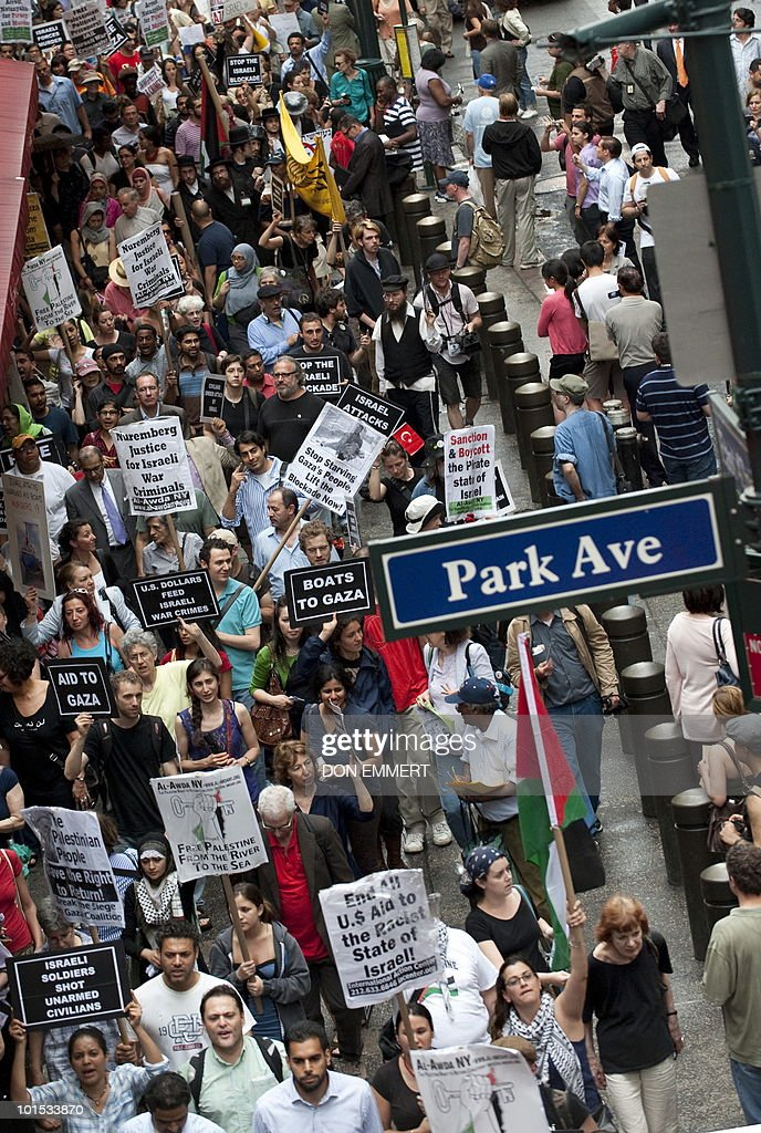 Marchers make their way past Grand Central Station on June 1, 2010 in New York during a protest against an Israeli raid on a Gaza-bound aid flotilla. US Secretary of State Hillary Clinton said the United States backs the Israeli investigation of the ship raid but it must be 'prompt, impartial, credible and transparent.'