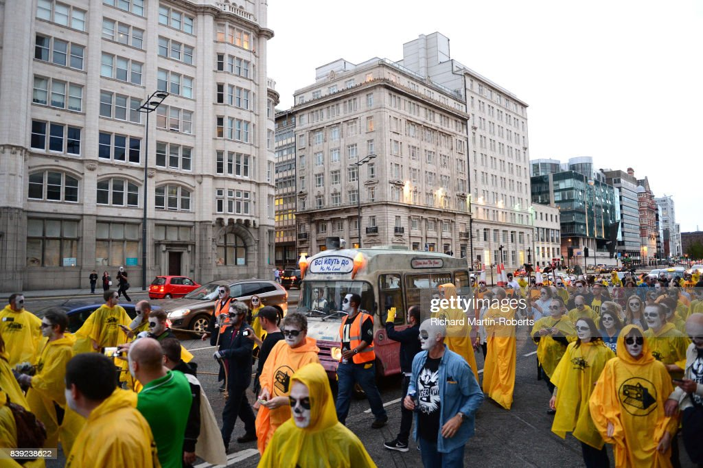 Marchers on The Great Pull North walk through Liverpool with The Justified Ancients of Mu Mu's Ice Cream Van on the Toxteth Day of the Dead as The Justified Ancients of Mu Mu Present 'Welcome To The Dark Ages' on August 25, 2017 in Liverpool, England.